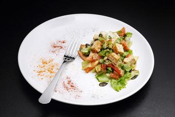 Tofu and vegetables salad. Black background
