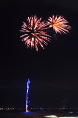 Beautiful bright fireworks over the ocean.