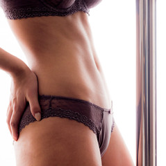 Beautiful belly of young pole dancer