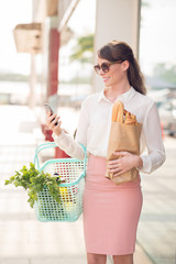 Business lady with groceries