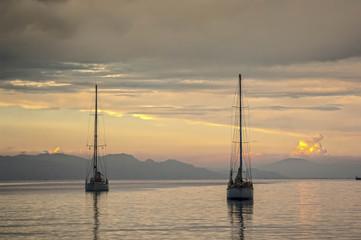 RHODES/GREECE 10TH OCTOBER 2006 - Ywo yachts enter Rhodes port a