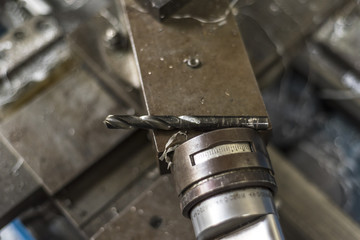 Metal drill bit on industrial lathe machine