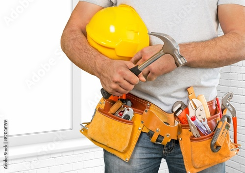 Adjustable. Handyman with a tool belt. House renovation service. - 82046159