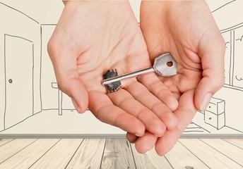 Key. Hands giving a key