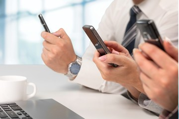 Mobile Phone. Text Messaging in a Meeting