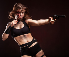 Woman warrior posing with knife. Ready to fight. With dirty face
