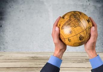Globe. Holding the world