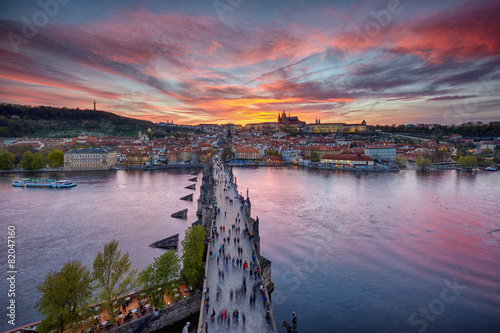 Foto op Canvas Praag sunset over Charles Bridge and Prague Castle