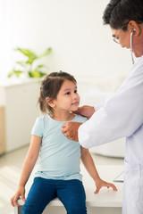 Examining little mixed-race girl