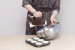 Woman with kitchen mixer whisking dough for cupcakes - 82049189