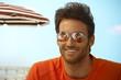 Happy handsome casual man wearing mirror shades