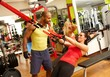 Fit woman doing suspension training