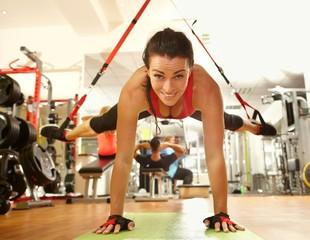Happy woman training in gym