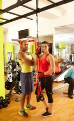 Fit man and woman in gym