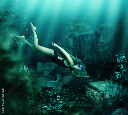 Fotobehang Duiken Woman swimming underwater. Adventure