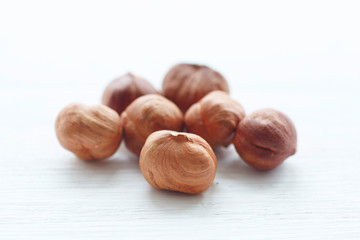 Hazelnuts on white wooden table