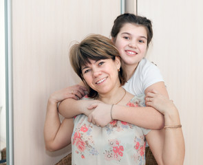Portrait of    woman with her   daughter