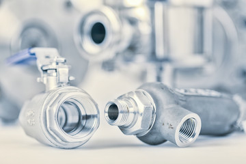 Fittings and ball valve with selective focus on thread fittings.
