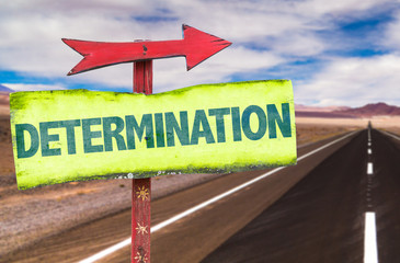 Determination sign with road background