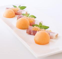 Molecular melon caviar, prosciutto and fresh melon