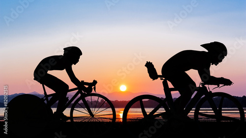 Staande foto Fietsen Triathlon at the beach evening time