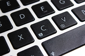 Perspective of the keyboard of a laptop in black and white blur