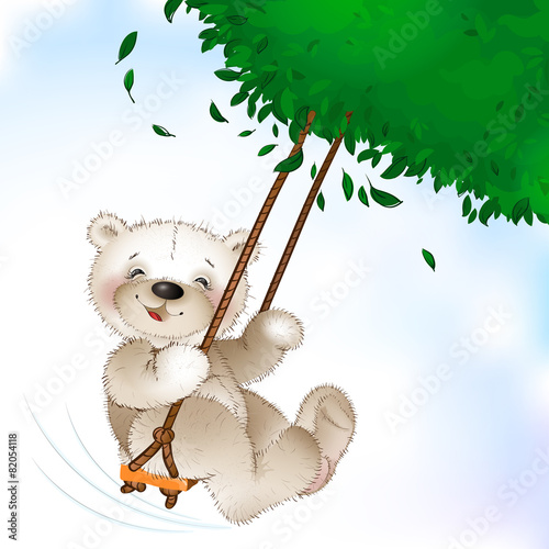 Happy Teddy bear riding on a swing