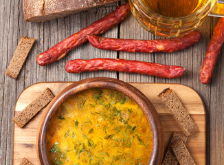 Dutch beer soup with sausage croutons parsley and beer in vintag
