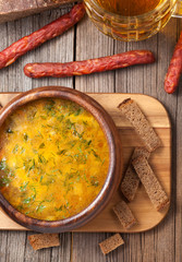 Dutch beer soup with sausage croutons parsley and beer on vintag