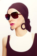 Fashionable lady in stylish summer accessory. Scarf and sunglass