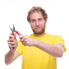 Bearded man holding pliers
