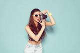 Fototapety fashion stylish woman dancing and making photo using retro