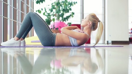 girl doing exercises in the gym