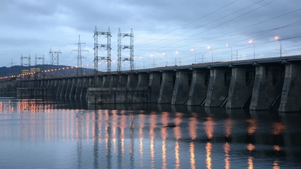 Hydroelectric power station in the evening. Timelapse