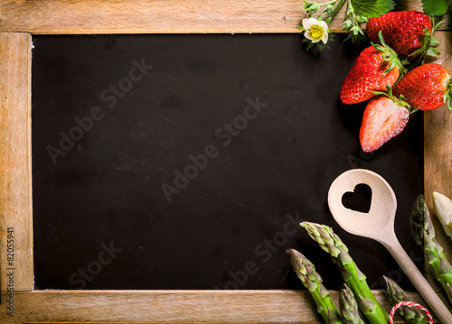 Empty Chalkboard with Asparagus, Berries and Ladle