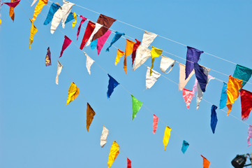 colorful bunting flags on blue sky