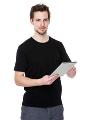Caucasian man use of tablet