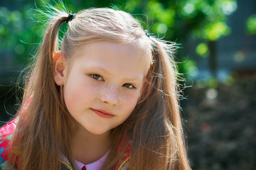 Portrait of a beautiful girl in the garden