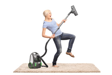 Woman playing guitar on vacuum cleaner