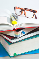Book stack with reading glasses