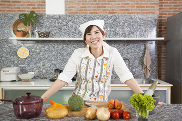 Woman Chef, An Asian woman chef pose showing cooking