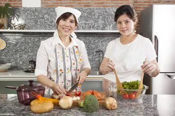 pregnancy cook, a pregnancy tummy woman cooking fresh salad