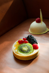 fresh fruit tart on leather background