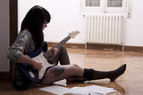 Fototapety girl playing guitar indoors, lifestyle