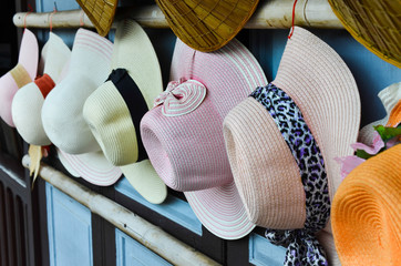 Vintage hats on the wooden wall