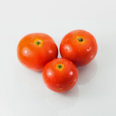Three tomatoes isolated on white background