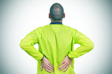 young sportsman with low back pain