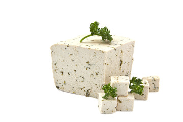 Fresh piece of tofu with parsley isolated on white background