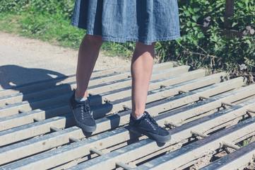 Woman walking on cattle grid