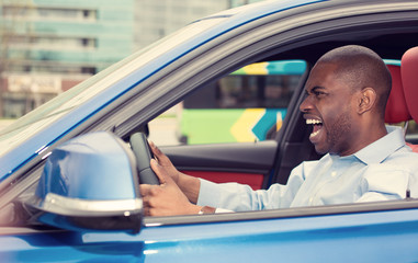 angry pissed off aggressive young man driving car shouting